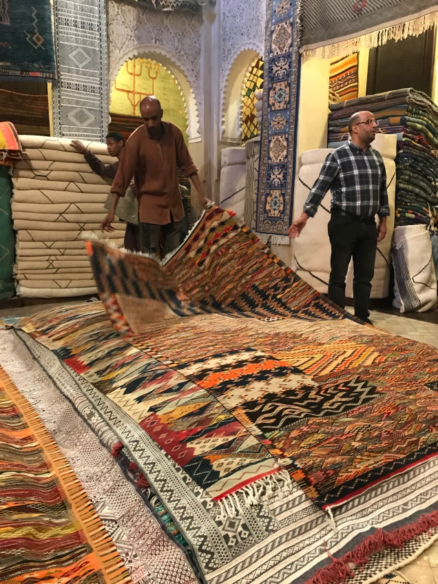With many patterns woven into one rug, customers learn the origin of the weave and the design.