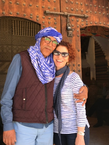 Chef Joanne Weir gets a hug from a favorite rug salesman in Marrakech.