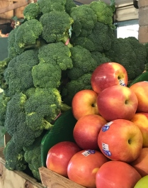 Fresh broccoli and ripe fall apples at West Side Market