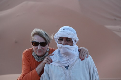 Posing with the guide who would help me mount a camel -- hopefully!