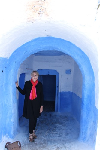 Perhaps a perfect place to pose for a picture: under a blue arched doorway in Chefchouen.
