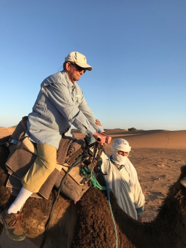 Success! Bert mounts a camel!